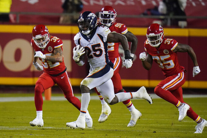Denver Broncos running back Melvin Gordon (25) runs the ball against the Kansas City Chiefs in the first half of an NFL football game in Kansas City, Mo., Sunday, Dec. 6, 2020. (AP Photo/Jeff Roberson)