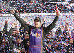 FILE - In this Sunday, Feb. 21, 2016, file photo, Denny Hamlin celebrates in Victory Lane after winning the NASCAR Daytona 500 Sprint Cup Series auto race at Daytona International Speedway in Daytona Beach, Fla. Hamlin is on the verge of announcing some sort of ownership group as the three-time Daytona 500 winner prepares for his future. (AP Photo/Chuck Burton, File)