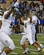 FILE - In this Oct. 12, 2018, file photo, South Florida's Coby Weiss (24) celebrates his go-ahead field goal in the final minutes of the team's NCAA college football game against Tulsa, in Tulsa, Okla. Thanks to three fourth-quarter comebacks, No. 21 South Florida remains one of eight unbeaten teams in the Football Bowl Subdivision. Connecticut plays at South Florida on Saturday, Oct. 20, 2018. (AP Photo/Sue Ogrocki, File)