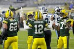 Green Bay Packers' Aaron Rodgers reacts with teammates after running for a touchdown during the first half of an NFL football game against the Carolina Panthers Saturday, Dec. 19, 2020, in Green Bay, Wis. (AP Photo/Mike Roemer)
