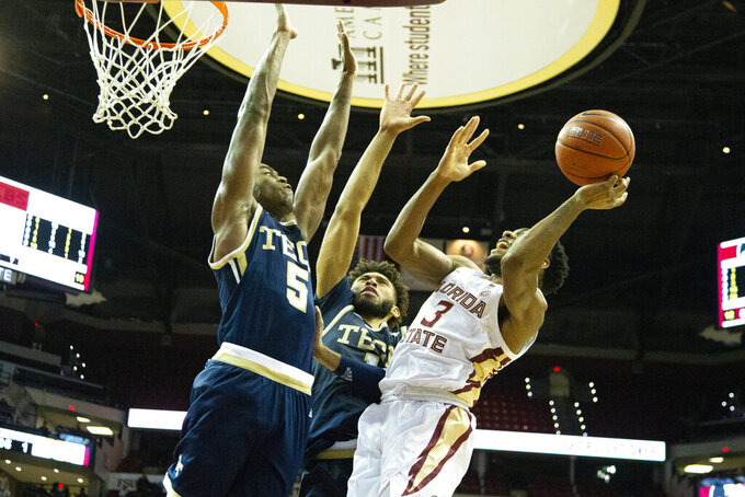 Florida State guard Trent Forrest (3) attempts to shoot over Georgia Tech forward Moses Wright (5) and forward James Banks III (1) in the second half of an NCAA college basketball game in Tallahassee, Fla., Tuesday, Dec. 31, 2019. Florida State defeated Georgia Tech 70-58. (AP Photo/Mark Wallheiser)