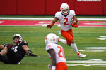 Illinois running back Chase Brown (2) runs past Nebraska linebacker JoJo Domann (13) during the first half of an NCAA college football game in Lincoln, Neb., Saturday, Nov. 21, 2020. (AP Photo/Nati Harnik)
