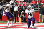 Northwestern running back Isaiah Bowser, right, and wide receiver Ramaud Chiaokhiao-Bowman celebrate Bowser's touchdown run against Rutgers during the first half of an NCAA college football game, Saturday, Oct. 20, 2018, in Piscataway, N.J. (AP Photo/Julio Cortez)