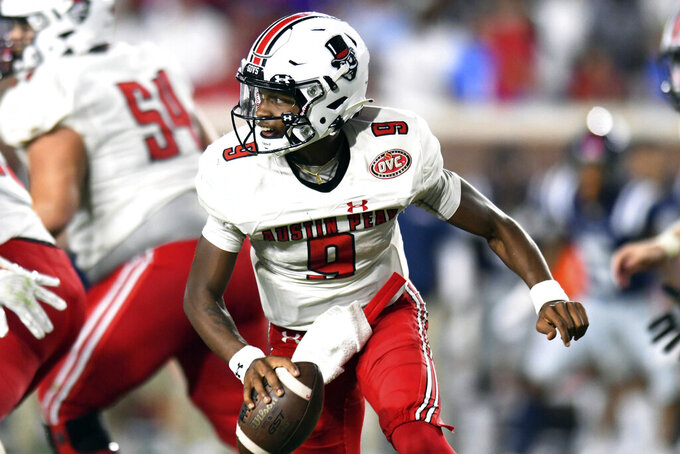 Austin Peay quarterback Draylen Ellis (9) rolls out against Mississippi during an NCAA college football game in Oxford, Miss., Saturday, Sept. 11, 2021. (AP Photo/Bruce Newman)