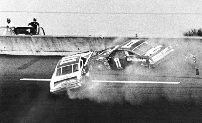 FILE - In this Feb. 18, 1979, file photo, Donnie Allison, in car 1, and Cale Yarborough, in car 11, crash on the last lap of the Daytona 500 which put Richard Petty in Victory Lane in Daytona Beach, Fla. Donnie Allison and his brother Bobby ended up in a fight with Cale Yarborough because of the wreck. The 1979 race was instrumental in broadening NASCAR's southern roots. Forty years later, it still resonates as one of the most important days in NASCAR history. (AP Photo/Ric Feld, File)