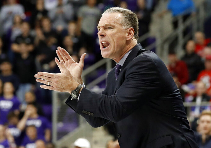 TCU head coach Jamie Dixon instructs his team in the second half of an NCAA college basketball game against Texas Tech in Fort Worth, Texas, Saturday, March 2, 2019. (AP Photo/Tony Gutierrez)