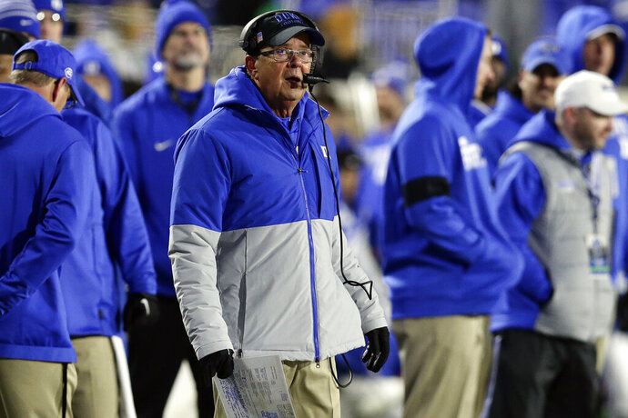 Duke head coach David Cutcliffe looks on from the sidelines during the second half of an NCAA college football game against Notre Dame in Durham, N.C., Saturday, Nov. 9, 2019. (AP Photo/Gerry Broome)