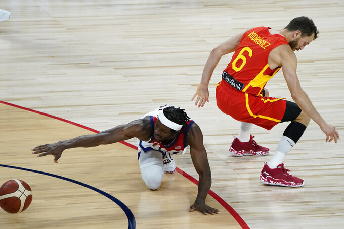 United States' Jerami Grant, left, and Spain's Sergio Rodriguez (6) scramble for the ball during the second half of an exhibition basketball game in preparation for the Olympics, Sunday, July 18, 2021, in Las Vegas. (AP Photo/John Locher)