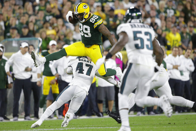 Green Bay Packers tight end Marcedes Lewis hurdles Philadelphia Eagles linebacker Nate Gerry during the first half of an NFL football game Thursday, Sept. 26, 2019, in Green Bay, Wis. (AP Photo/Jeffrey Phelps)