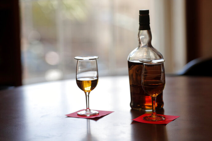 A whiskey sample is seen in a tasting room during a media preview for the Sazerac house, in New Orleans, Tuesday, Sept. 10, 2019. Visitors to New Orleans who want to learn more about cocktails will soon have a new place to go. No, it's not another bar. The Sazerac House is a six-story building on the city's famed Canal Street owned by the Sazerac Company, a Louisiana-based spirits maker, featuring the signature New Orleans drink called the Sazerac.Tasting is encouraged, and in addition to free samples given to visitors, there will also be special classes and tastings offered daily. (AP Photo/Gerald Herbert)