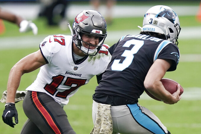 Carolina Panthers punter Joseph Charlton (3) runs on a fake punt against Tampa Bay Buccaneers wide receiver Justin Watson (17) during the second half of an NFL football game, Sunday, Nov. 15, 2020, in Charlotte , N.C. (AP Photo/Gerry Broome)