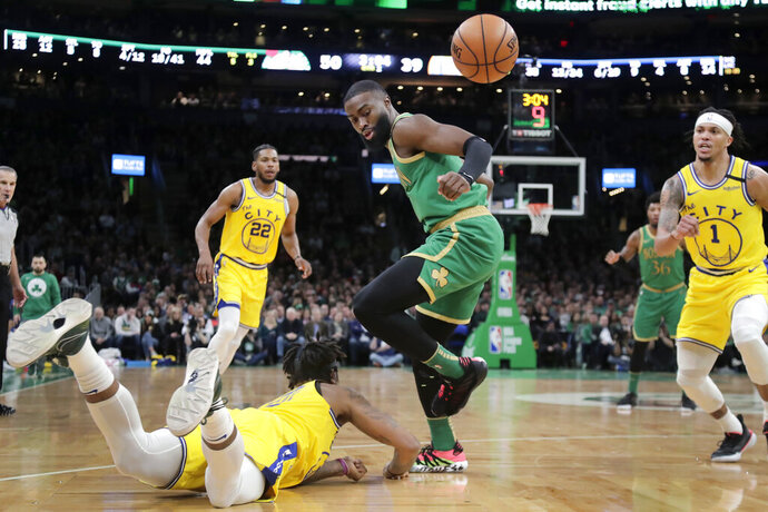 A loose ball bounces away from Golden State Warriors forward Marquese Chriss, on floor, and Boston Celtics guard Jaylen Brown, as Warriors guard Damion Lee (1) watches at right during the second quarter of an NBA basketball game, Thursday, Jan. 30, 2020, in Boston. (AP Photo/Elise Amendola)
