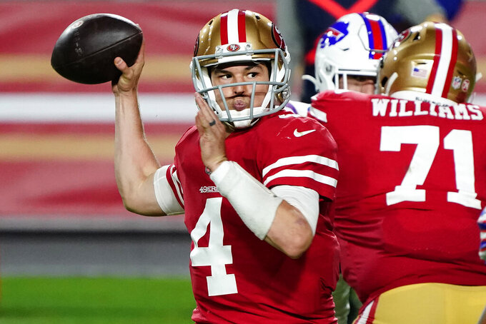 San Francisco 49ers quarterback Nick Mullens (4) throws against the Buffalo Bills during the second half of an NFL football game, Monday, Dec. 7, 2020, in Glendale, Ariz. (AP Photo/Rick Scuteri)