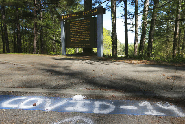 Someone has spray painted over the blue line for handicapped parking and has marked it COVID-19 parking along the Natchez Trace near Tupelo, Miss., Thursday, April 2, 2020. (Thomas Wells/The Northeast Mississippi Daily Journal via AP)