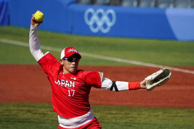 Japan's Yukiko Ueno (17) pitches against Canada in a softball game in Yokohama Baseball Stadium, at the 2020 Summer Olympics, Sunday, July 25, 2021, in Yokohama, Japan. (AP Photo/Sue Ogrocki)