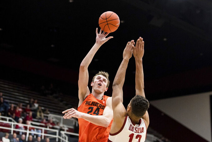 Oregon State forward Kylor Kelley (24) shoots as Stanford forward Oscar da Silva (13) defends during the second half of an NCAA college basketball game, Thursday, Jan. 30, 2020, in Stanford, Calif. Oregon State won 68-63. (AP Photo/John Hefti)