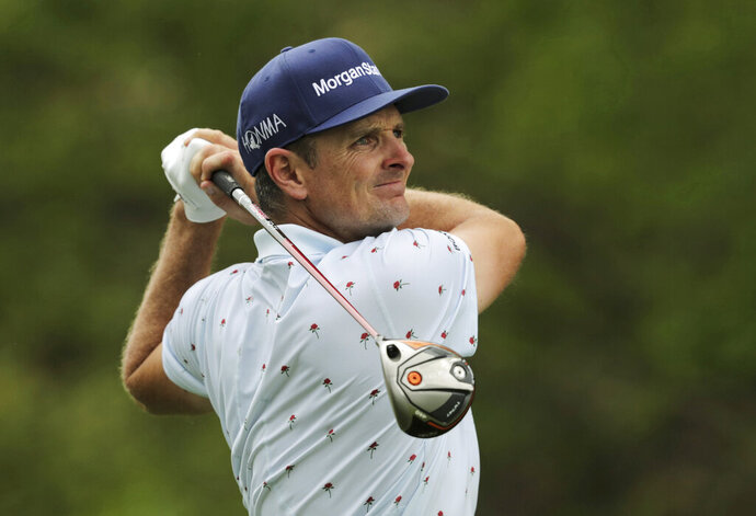 Justin Rose drives off the 10th tee during the final round of the PGA Championship golf tournament, Sunday, May 19, 2019, at Bethpage Black in Farmingdale, N.Y. (AP Photo/Charles Krupa)