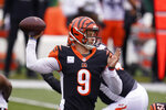 Cincinnati Bengals quarterback Joe Burrow (9) throws during the first half of an NFL football game against the Cleveland Browns, Sunday, Oct. 25, 2020, in Cincinnati. (AP Photo/Michael Conroy)