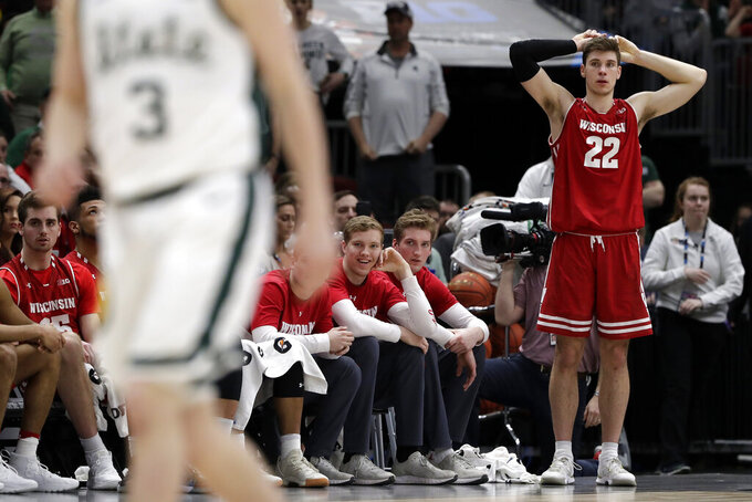 Wisconsin's Ethan Happ (22) reacts as players watch from the bench during the second half of an NCAA college basketball game against Michigan State in the semifinals of the Big Ten Conference tournament, Saturday, March 16, 2019, in Chicago. Michigan State won 67-55. (AP Photo/Nam Y. Huh)