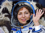 FILE - In this Sept. 29, 2006 file photo, U.S. space tourist Anousheh Ansari waves shortly after landing near the town of Arkalyk, northern Kazakhstan. CEO of the XPRIZE Foundation, Ansari, funded the first prize for $10 million for private space flight. The 2019 XPRIZE, also for $10 million, funded by entrepreneur Elon Musk, presented a challenge: Come up with open-sourced software that could easily be downloaded onto tablets used by illiterate children to teach themselves to read. The winner of this latest competition for global innovation is being announced Wednesday, May 15, 2019, in Los Angeles. (AP Photo/Misha Japaridze, File)