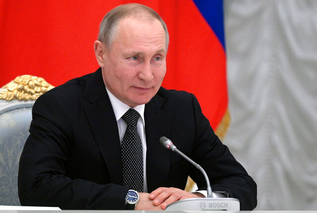 Russian President Vladimir Putin speaks during a meeting with members of a working group created to discuss constitutional amendments in Moscow, Russia, Wednesday, Feb. 26, 2020. The working group proposed holding a nationwide vote on the changes on April 22. (Alexei Druzhinin, Sputnik, Kremlin Pool Photo via AP)