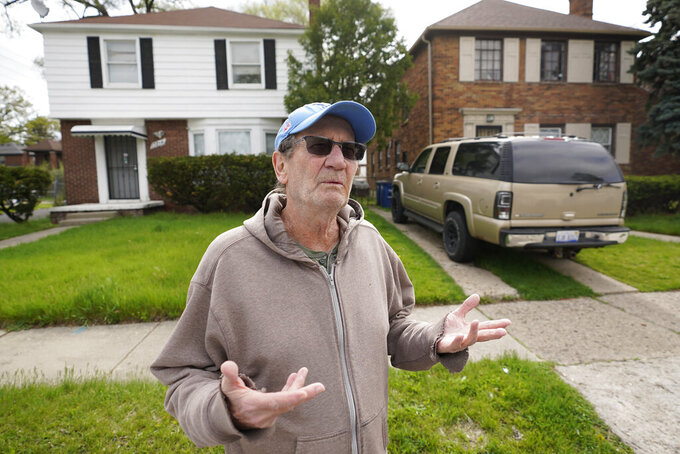 Nick Sbrocca talks about getting Covid-19 vaccinations in Detroit, Tuesday, May 4, 2021. Officials are walking door-to-door to encourage residents of the majority Black city to get vaccinated against COVID-19 as the city's immunization rate lags well behind the rest of Michigan and the United States. (AP Photo/Paul Sancya)