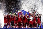 Liverpool's Jordan Henderson lifts the trophy after winning the Champions League final soccer match between Tottenham Hotspur and Liverpool at the Wanda Metropolitano Stadium in Madrid, Saturday, June 1, 2019. (AP Photo/Manu Fernandez)