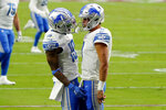 Detroit Lions wide receiver Kenny Golladay celebrate his touchdown catch with quarterback Matthew Stafford during the first half of an NFL football game against the Arizona Cardinals, Sunday, Sept. 27, 2020, in Glendale, Ariz. (AP Photo/Rick Scuteri)
