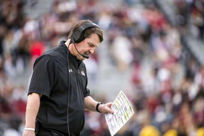 AP source: South Carolina demotes OC, fires 2 assistants