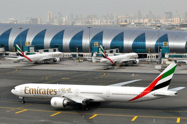 FILE - In this March 22, 2017, file photo, an Emirates plane taxis to a gate at Dubai International Airport in Dubai, United Arab Emirates. The Middle East's biggest carrier, Emirates, declared on Sunday, May 10, 2020, higher profits of $288 million over the past year even as revenue declined due to flight suspensions sparked by the coronavirus, offering a glimpse of the financial toll now facing airlines around the world. (AP Photo/Adam Schreck, File)