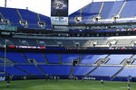Baltimore Ravens warm up during an NFL football training camp practice in an empty stadium, Saturday, Aug. 29, 2020, in Baltimore, Md.(AP Photo/Gail Burton)