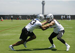 Oakland Raiders tight ends Darren Waller, left, and Luke Willson take part in a drill during NFL football minicamp Tuesday, June 11, 2019, in Alameda, Calif. (AP Photo/Eric Risberg)