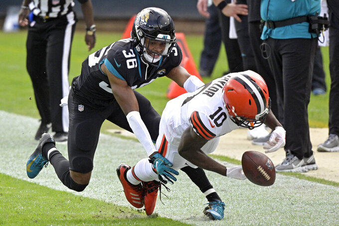 Jacksonville Jaguars cornerback Luq Barcoo (36) breaks up a pass intended for Cleveland Browns wide receiver Taywan Taylor (10) during the first half of an NFL football game, Sunday, Nov. 29, 2020, in Jacksonville, Fla. (AP Photo/Phelan M. Ebenhack)