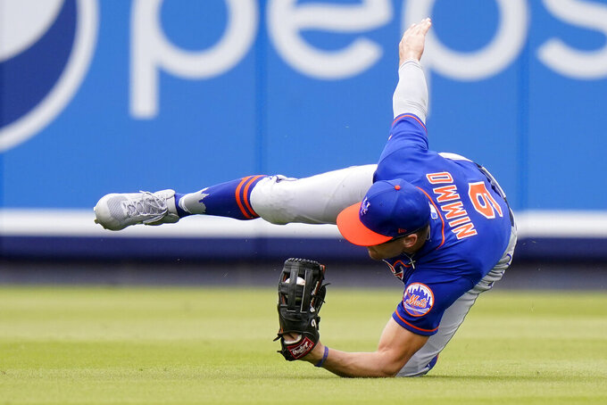 New York Mets center fielder Brandon Nimmo (9) catches a ball hit by Washington Nationals 'Trea Turner during the fifth inning of a spring training baseball game, Monday, March 8, 2021, in West Palm Beach, Fla. (AP Photo/Lynne Sladky)