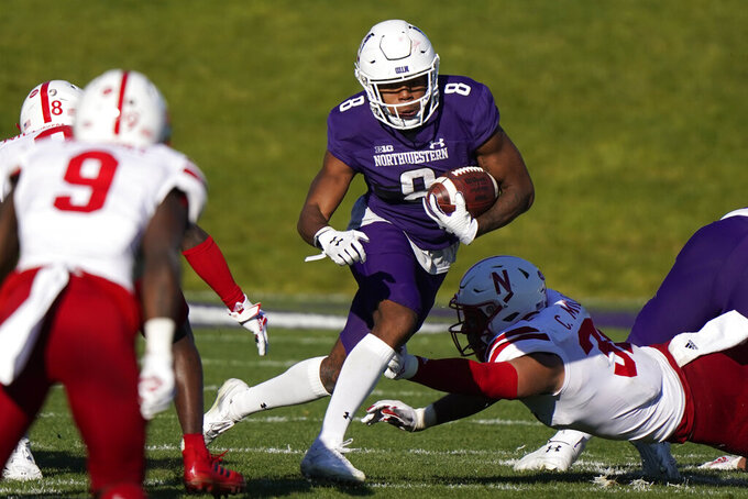 Northwestern wide receiver Kyric McGowan, center, runs with the ball against Nebraska during the second half of an NCAA college football game in Evanston, Ill., Saturday, Nov. 7, 2020. Northwestern won 21-13. (AP Photo/Nam Y. Huh)