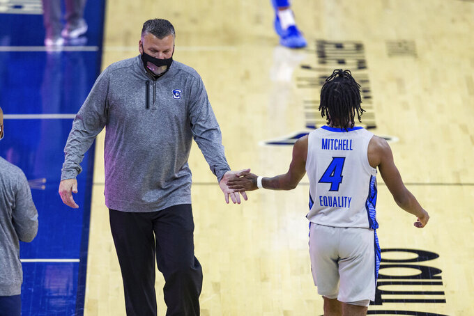 Creighton coach Greg McDermott slaps hands with guard Shereef Mitchell during the first half against Seton Hall in an NCAA college basketball game Wednesday, Jan. 6, 2021, in Omaha, Neb. (AP Photo/John Peterson)