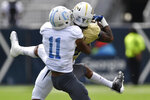 Georgia Tech wide receiver Malachi Carter (15) makes the catch ahead of The Citadel defensive back Phil Barrett (11) during the first half of an NCAA college football game, Saturday, Sept. 14, 2019, in Atlanta. (AP Photo/Mike Stewart)