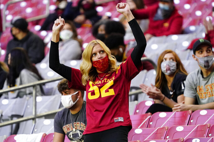 An Iowa State fan cheers during the second half of the Fiesta Bowl NCAA college football game against Oregon, Saturday, Jan. 2, 2021, in Glendale, Ariz. (AP Photo/Rick Scuteri)