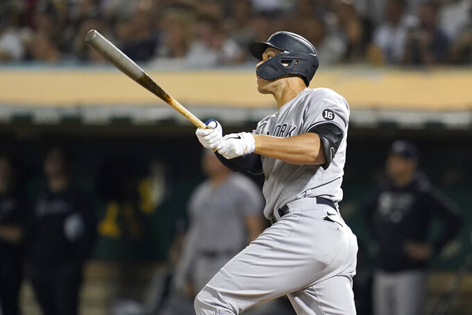 New York Yankees' Aaron Judge watches his three-run home run against the Oakland Athletics during the fifth inning of a baseball game in Oakland, Calif., Friday, Aug. 27, 2021. (AP Photo/Jeff Chiu)