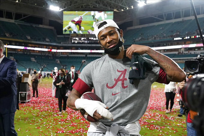 Alabama wide receiver DeVonta Smith leaves the field after their win against Ohio State in an NCAA College Football Playoff national championship game, Tuesday, Jan. 12, 2021, in Miami Gardens, Fla. Alabama won 52-24. (AP Photo/Lynne Sladky)