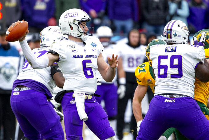 James Madison quarterback Ben DiNucci (6) looks to pass during the first half of the FCS championship NCAA college football game against North Dakota State, Saturday, Jan. 11, 2020, in Frisco, Texas. (AP Photo/Sam Hodde)