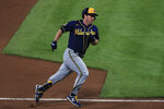 Milwaukee Brewers' Jedd Gyorko runs the bases after hitting a solo home run in the fifth inning during a baseball game against the Cincinnati Reds in Cincinnati, Monday, Sept. 21, 2020. (AP Photo/Aaron Doster)