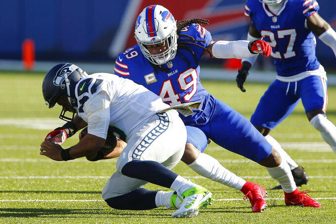 Buffalo Bills middle linebacker Tremaine Edmunds (49) sacks Seattle Seahawks' Russell Wilson (3) during the first half of an NFL football game Sunday, Nov. 8, 2020, in Orchard Park, N.Y. (AP Photo/John Munson)