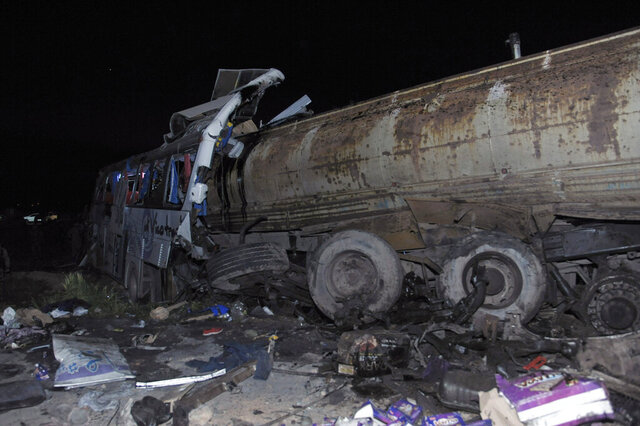 This Saturday, March. 7, 2020 photo, released by the Syrian official news agency SANA, shows a fuel tanker that collided with two passenger buses and several other cars on the Damascus-Homs road near the capital Damascus, killing tens of people, Syria's official news agency said. Syria's Interior Minister Mohammed Khaled Rahmoun, who visited the area late Saturday, told reporters faulty brakes apparently caused the driver to lose control of the fuel tank. He said at least 15 other vehicles were damaged. (SANA via AP)