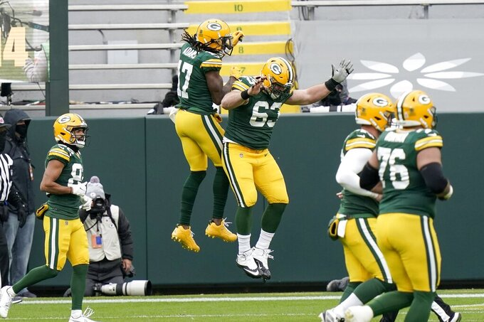 Green Bay Packers' Davante Adams celebrates his touchdown catch with Corey Linsley (63) during the first half of an NFL football game against the Minnesota Vikings Sunday, Nov. 1, 2020, in Green Bay, Wis. (AP Photo/Morry Gash)