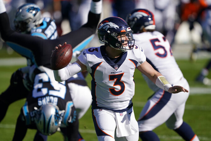 Denver Broncos quarterback Drew Lock passes against the Carolina Panthers during the first half of an NFL football game Sunday, Dec. 13, 2020, in Charlotte, N.C. (AP Photo/Brian Blanco)