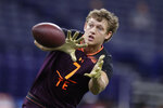 FILE - In this Saturday, March 2, 2019 file photo, Iowa tight end T.J. Hockenson runs a drill at the NFL football scouting combine in Indianapolis. Noah Fant and T.J. Hockenson spent their three years at Iowa trying to one-up each other in a friendly but fierce competition. So, why should the NFL draft be any different? The latest members of the Hawkeyes' long pipeline to the pros are expected to become the first tight end duo from the same school ever selected in the first round of the draft.(AP Photo/Michael Conroy, File)