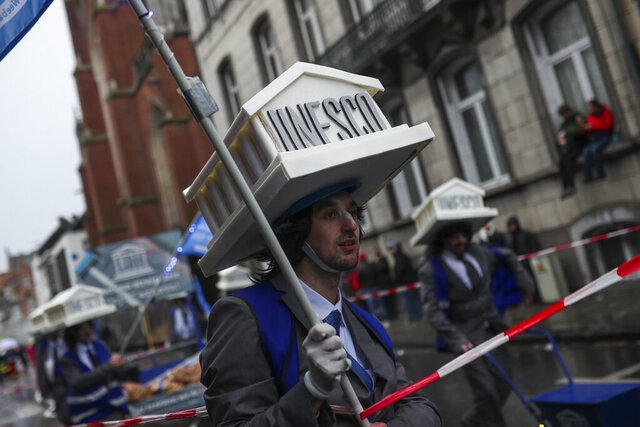 People dressed in carnival costumes with a UNESCO theme take part in the annual carnival parade in Aalst, Belgium, Sunday, Feb. 23, 2020. The Aalst Carnival parade included stereotypical depictions of Jews for the second year in a row and the Belgian government said that the anti-Semitism in the three-day festival embarrassed the nation and endangers society. The Carnival was kicked off the United Nations' UNESCO heritage list last year after a float rife with anti-Semitic symbols raised worldwide condemnation. (AP Photo/Francisco Seco)
