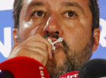 FILE - In this May 27, 2019 file picture, Italian Interior Minister and Deputy Premier Matteo Salvini kisses a crucifix as he talks to reporters during a press conference at the League headquarters in Milan, Italy. For months now, Salvini _ a divorced father of two children by two different women _ has been kissing rosaries, invoking the Madonna and quoting St. John Paul II at political rallies in a bid to rally Italian Catholics behind his nationalist message. (AP Photo/Antonio Calanni)