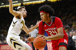 Rutgers forward Ron Harper Jr. drives past Iowa guard Jordan Bohannon, left, during the first half of an NCAA college basketball game, Saturday, March 2, 2019, in Iowa City, Iowa. (AP Photo/Charlie Neibergall)